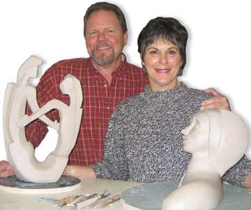 Hedy and Ross Hale inside their pottery studio gallery in Morro Bay California working on their original clay sculptures. Pottery classes are offered in Morro Bay, CA.
